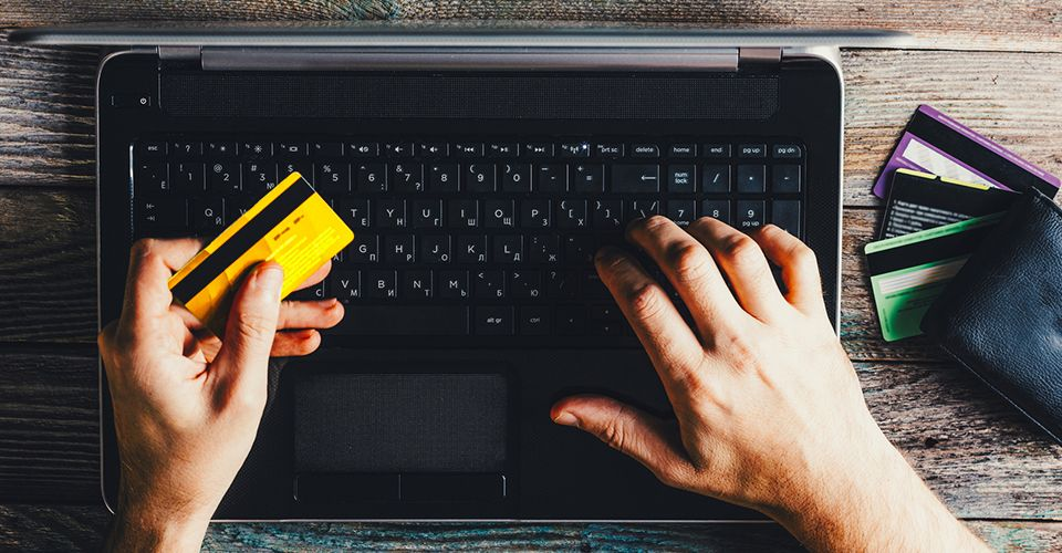 Is it better to pay by credit card or debit card online?